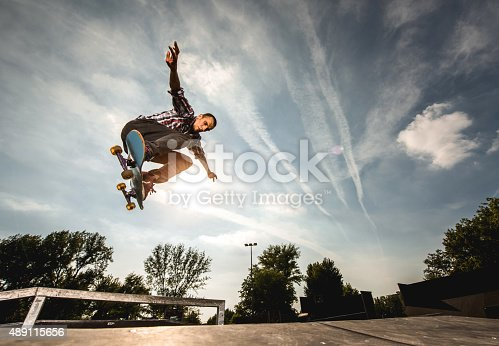 istock Extreme skateboarder in Ollie position against the sky. 489115656