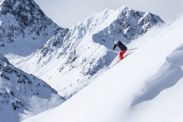 extreme skier in powder snow Expert skier showing skills land feature stock pictures, royalty-free photos & images
