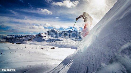 istock extreme skier in powder snow 869482458