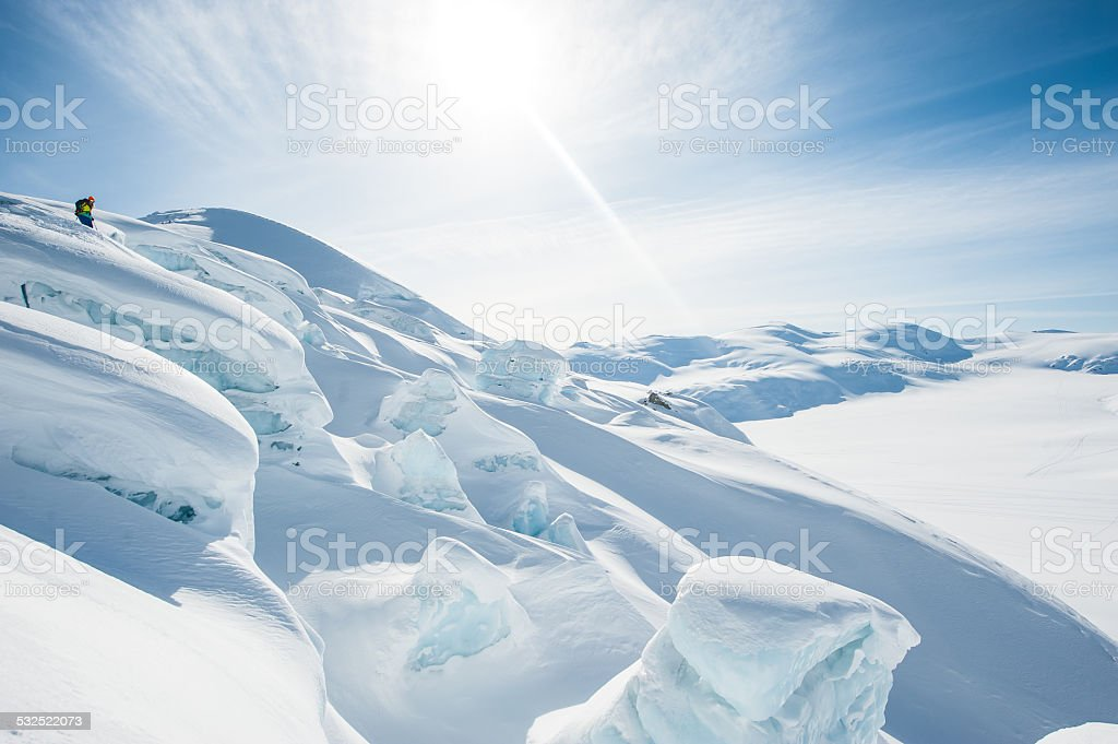 Extreme Skier Scouting Lines stock photo