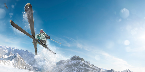 istock Extreme Skiing Girl in Mid Air Jump Action 527276355
