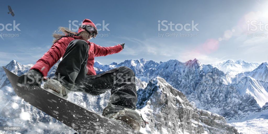 Extreme Snowboarding Girl stock photo