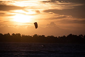 Extreme Sport Kitesurfing, wind surf, Surfer in the sea at sunset