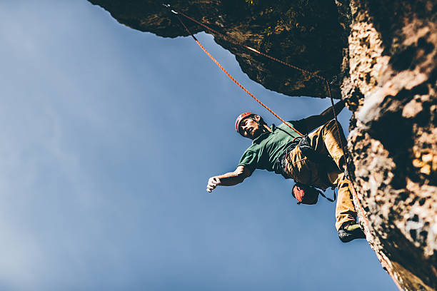 extreme sport lover - rock climbing stock photos and pictures