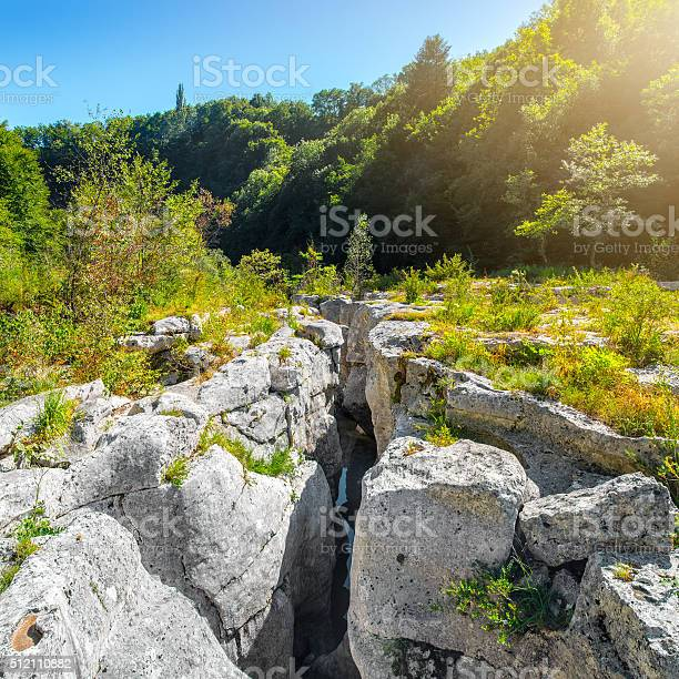 Photo of Extreme terrain eroded rock formation from waterhole landscape in France