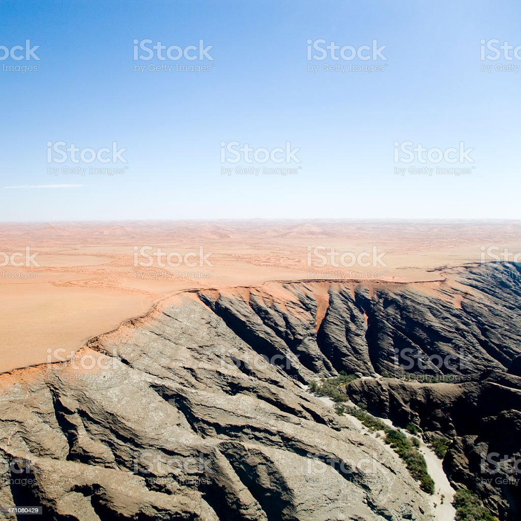 Extreme Terrain, Dark Grey Rock Valley with dried out River with some...