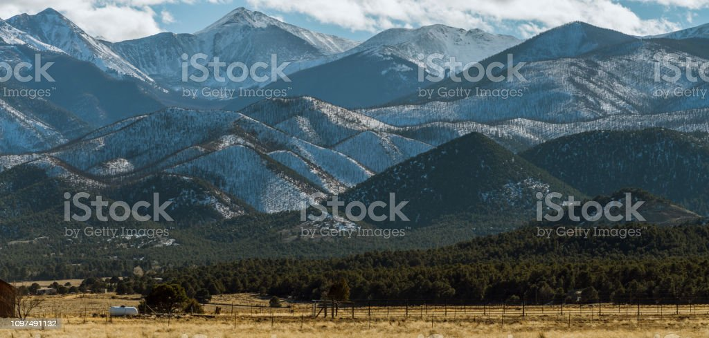 The extreme terrain. The remote view of the mountains covered by snow...