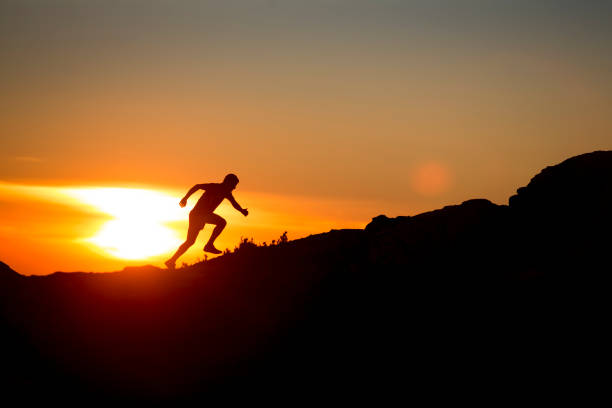 Extreme Trail running athlete at sunset Trail running athlete training at Serra do Marão, Portugal endurance stock pictures, royalty-free photos & images