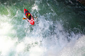 Paddling through rapids on a wild river. Extreme kayaker in the middle of a river.