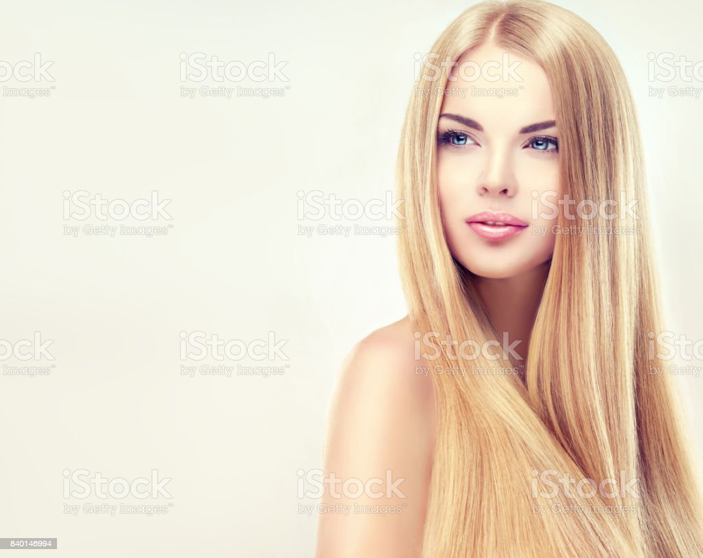 Extremely attractive blonde. Young, blonde haired woman  with long, straight,shiny hair. – zdjęcie