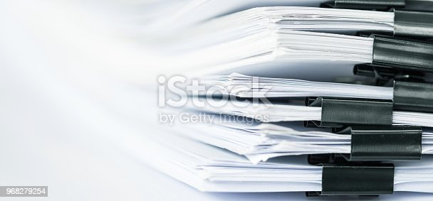 istock extremely close up  report paper stacking of office working document 968279254