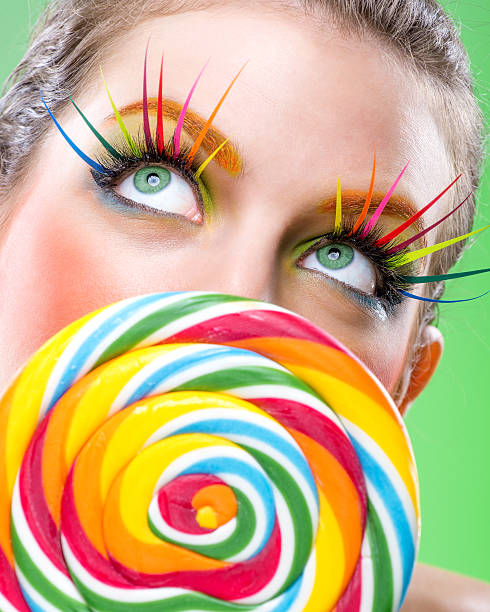 Extremely colorful lollipop, comes with matching makeup stock photo