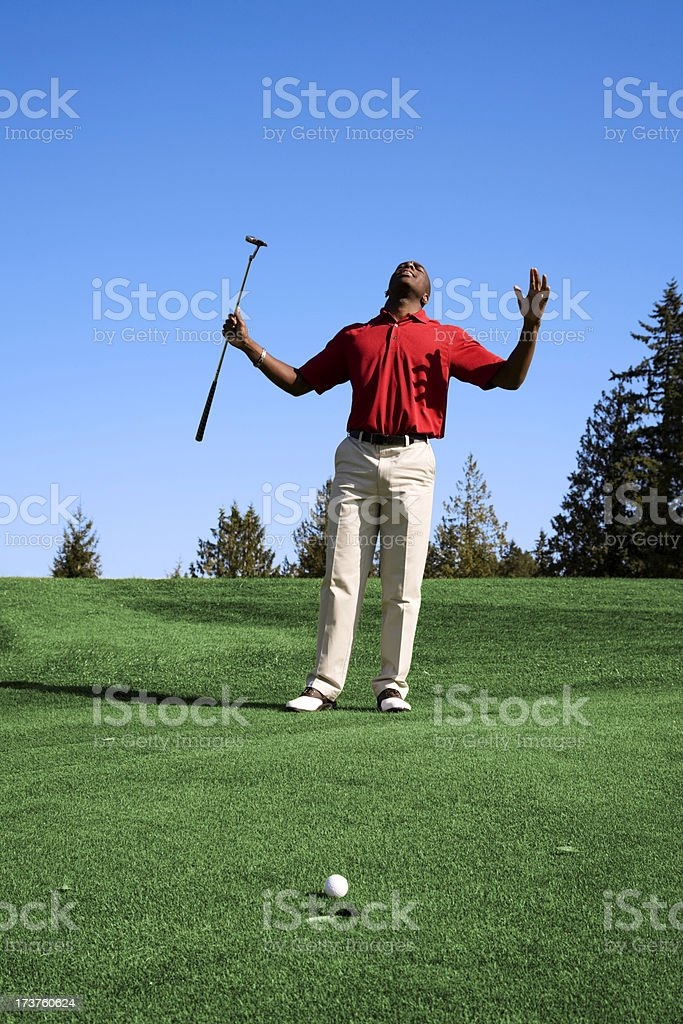Extremely disappointed Golfer golf course green grass black man royalty-free stock photo