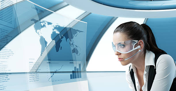 Extremely sensual young woman in futuristic headset and transparent screen stock photo