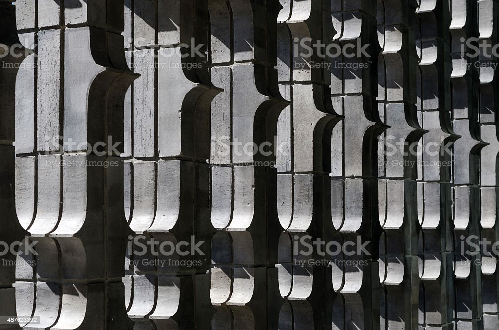 Extruded brick wall with light stock photo