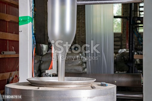 istock Extruder blows new plastic bags out of recycled plastic waste 1190467514