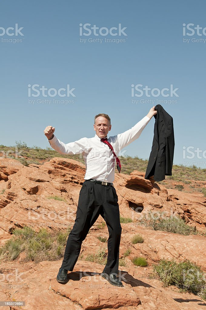 Exuberant businessman screaming with joy in the harsh environment (VI) stock photo