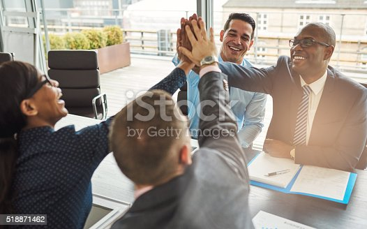 istock Exultant team of business professionals 518871462