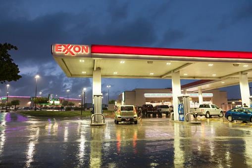 Dallas, USA - April 17, 2016: Exxon gas station illuminated at night. Dallas, Texas, United States