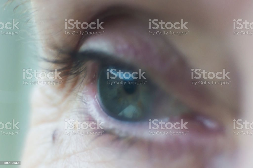 Eye blue , mature woman stock photo