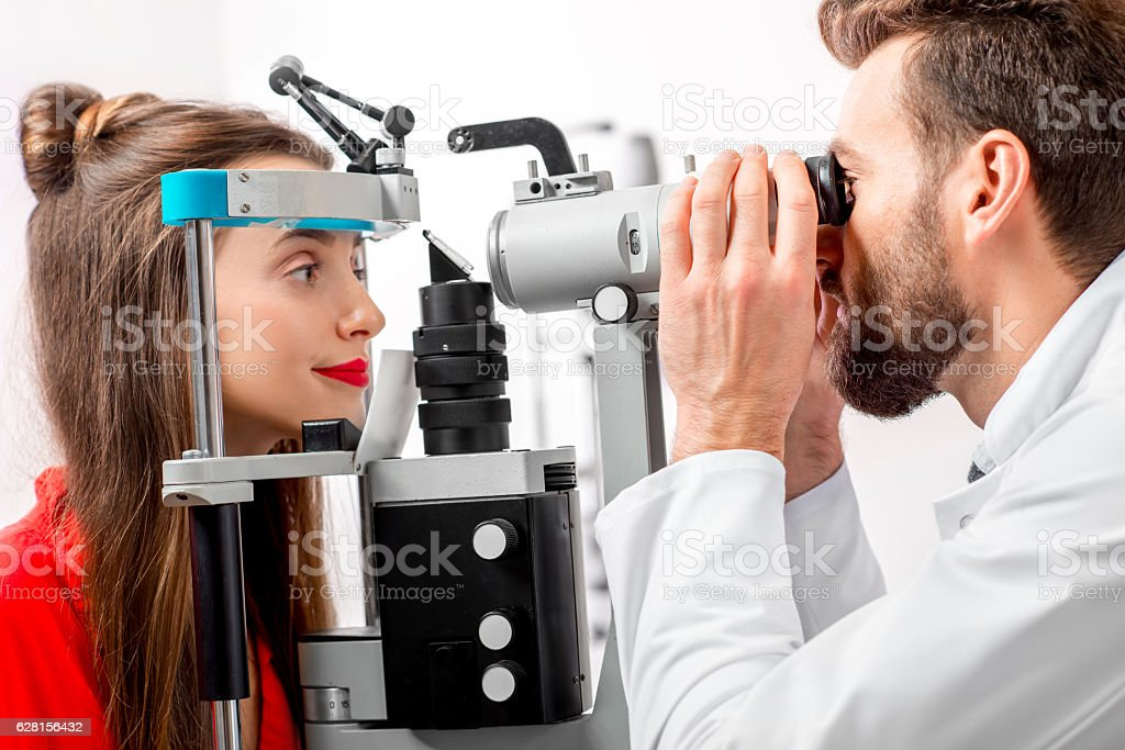 Eye doctor checking vision stock photo
