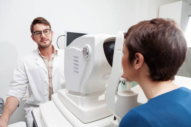 eye Doctor is measuring a patient's visual field stock photo