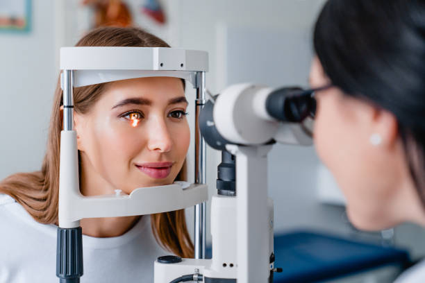 Eye doctor with female patient during an examination in modern clinic Medicine, Hospital, Medical Clinic, Ophtalmologist, Exam optical instrument stock pictures, royalty-free photos & images