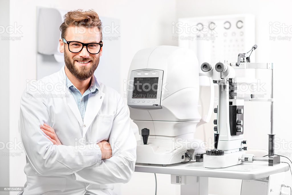Eye doctor with ophthalmologic device stock photo