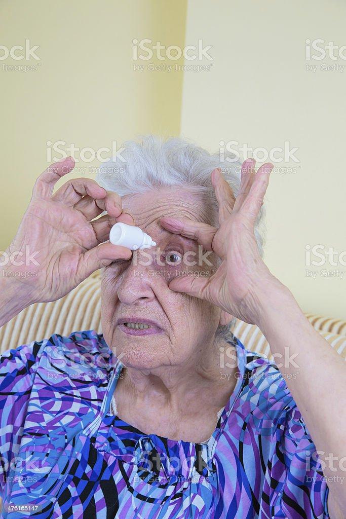 eye dropping stock photo