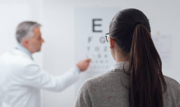 eye exam - medical test stock pictures, royalty-free photos & images