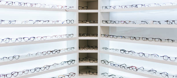 Eye glasses in ophthalmology clinic Big choice of eyeglasses on shelves in ophthalmology clinic. Modern light ophthalmology clinic. optical instrument stock pictures, royalty-free photos & images