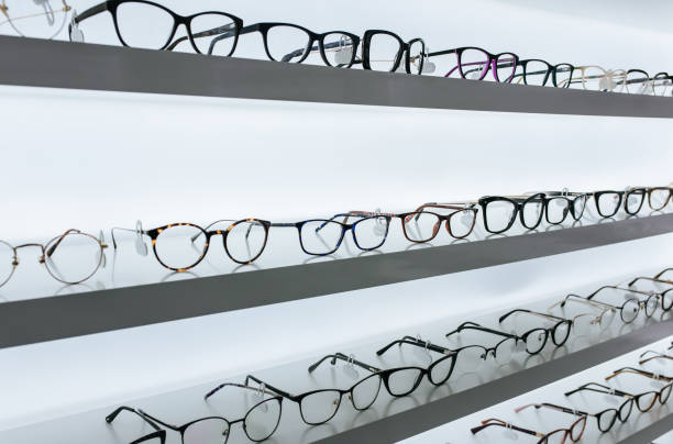 eye glasses in ophthalmology clinic - sale lenses stock photos and pictures