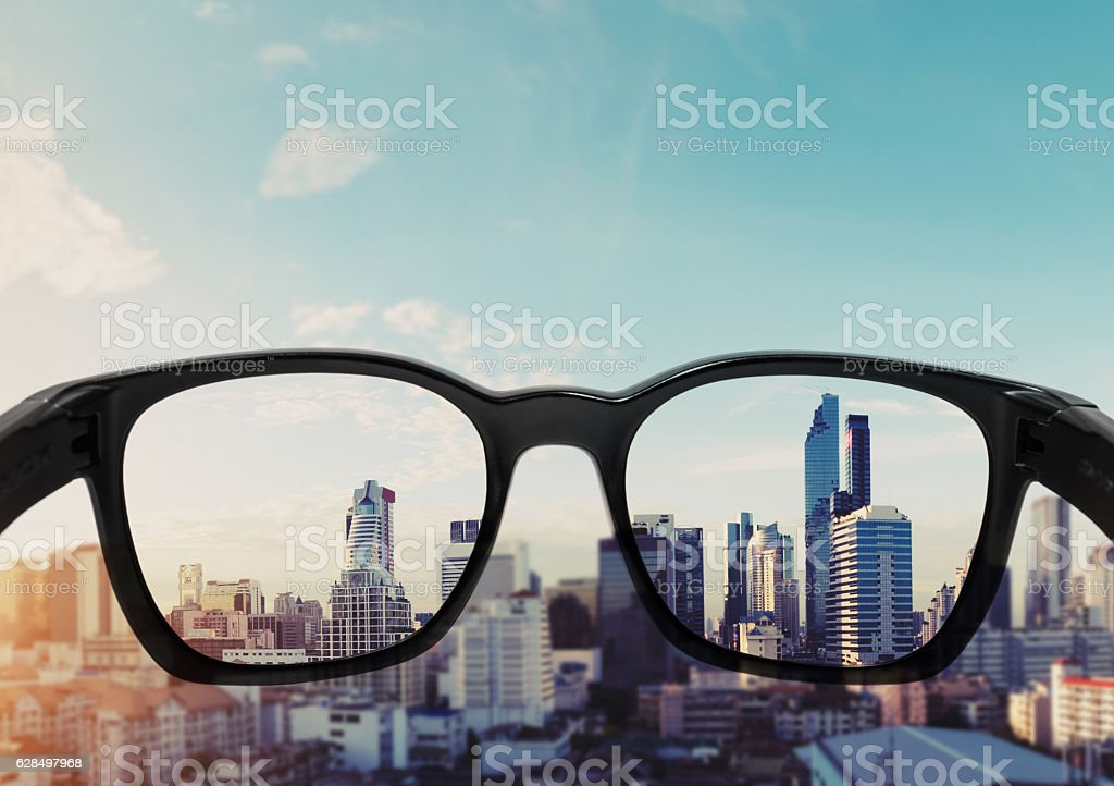 Eye glasses looking to city view, focused on glasses lens royalty-free stock photo