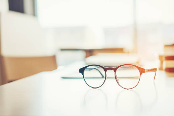 Eye Glasses on the study table education concept stock photo