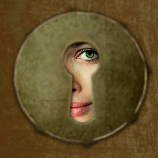 eye in key hole eye in key hole creepy stalker stock pictures, royalty-free photos & images