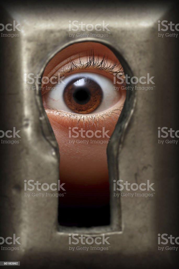 Oko w dziurkę od klucza - Zbiór zdjęć royalty-free (Ciekawość)