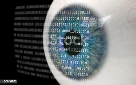 istock Eye Looking at Binary Code. 180846762