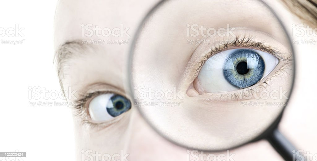 Eye looking thorough magnifying glass royalty-free stock photo