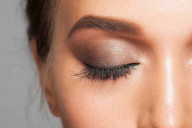 Eye makeup Closeup image of closed woman eye with beautiful bright makeup, smoky eyes eyes closed woman stock pictures, royalty-free photos & images