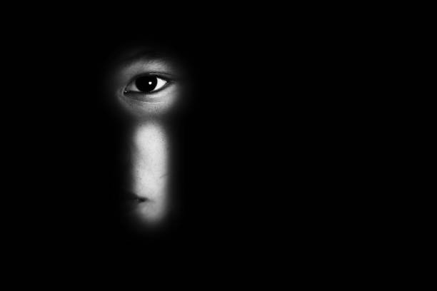 eye of boy through key whole, child abuse concept eye of boy through key whole, child abuse concept abuse stock pictures, royalty-free photos & images
