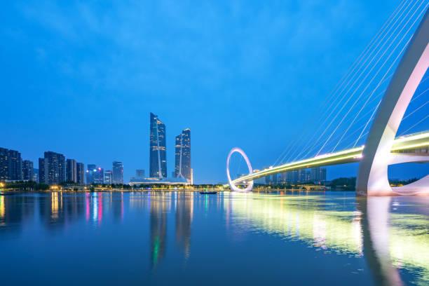 Eye of Nanjing Pedestrian Bridge and urban skyline in Jianye District, Nanjing, China stock photo