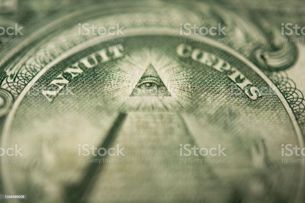 Eye of Providence or all-seeing eye sign, detail in the banknote of one dollar royalty-free stock photo