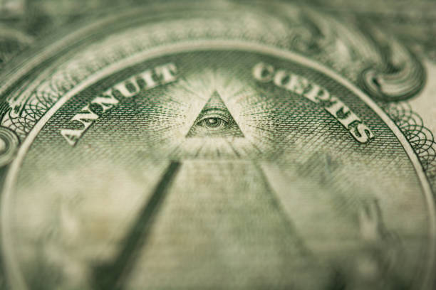 Eye of Providence or all-seeing eye sign, detail in the banknote of one dollar stock photo