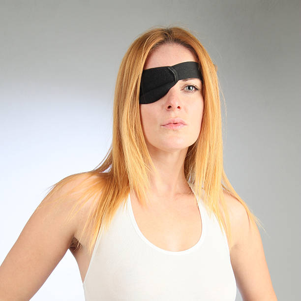 Eye patch Young woman wearing eye patch costume eye patch stock pictures, royalty-free photos & images