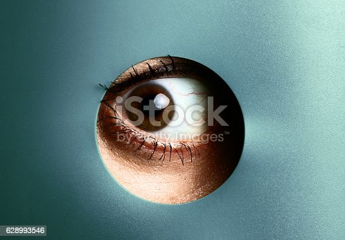 Eye peeking through hole
