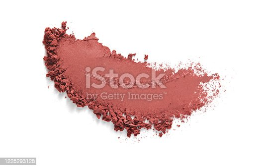 Eye shadow swatch. Bronzer smudge. Face makeup powder texture. Terracotta eyeshadow stroke isolated on white background. Beauty product macrophotography