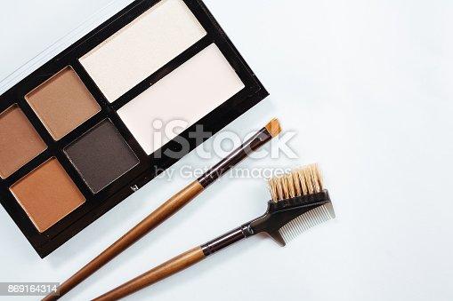 istock Eye shadow with brush on white background 869164314