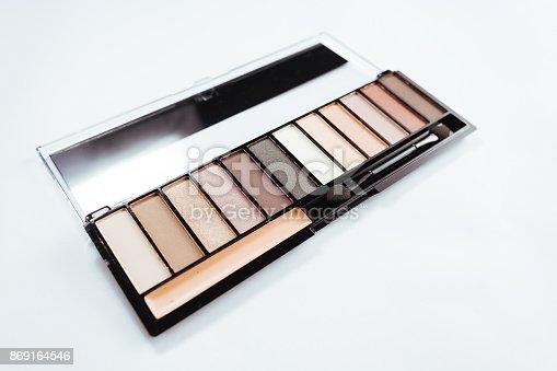 istock Eye shadow with brush on white background 869164546