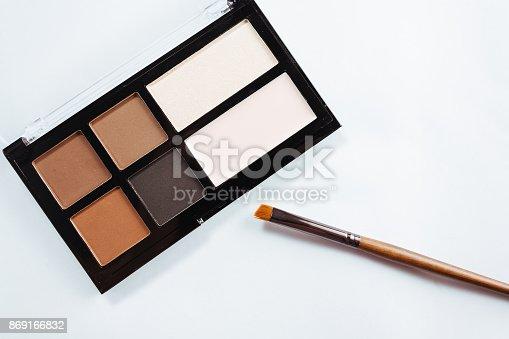 istock Eye shadow with brush on white background 869166832
