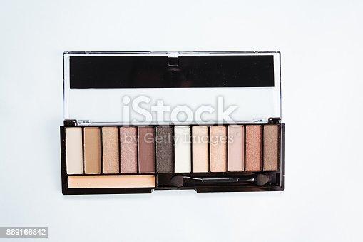 istock Eye shadow with brush on white background 869166842